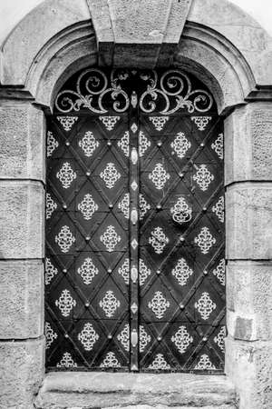 door entrance to the historic building black and white photo