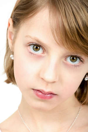 Studio portrait of young beautiful girl with nice eyes on white background photo