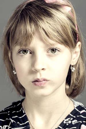 preteen model: Studio portrait of young beautiful girl with nice eyes on black