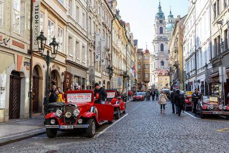praga: PRAGUE, CZECH REPUBLIC - MARCH 13th, 2014 - Famous historic red car Praga in Prague street. Praga is a manufacturing company founded in 1907 based in Prague, Czech Republic. Editorial