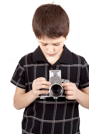 viewfinder vintage: young boy with old vintage analog SLR camera looking to viewfinder