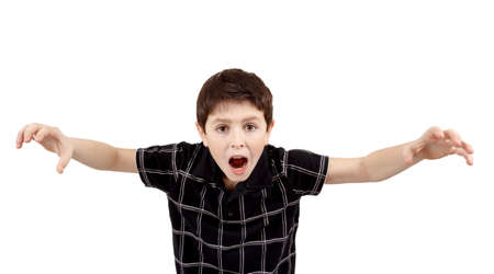Young boy grimacing and scares isolated on white background photo
