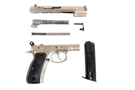 real Semi automatic gun disassembled on white background photo
