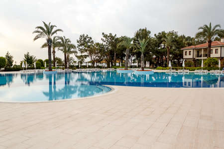 swimming pool in resort with nobody at early morning Editorial