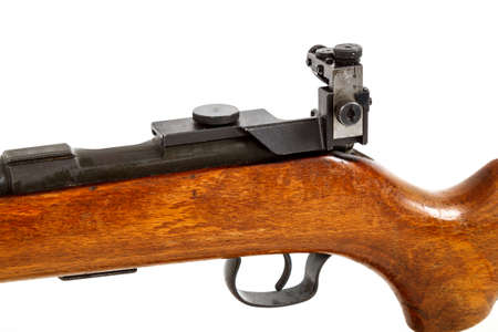 vintage riffle: detail of old bolt action rifle isolated on white background