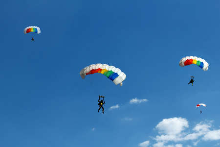 paradglider: unidentified skydivers on blue sky Stock Photo