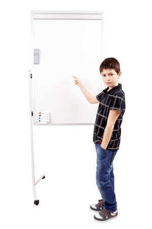 young boy student in a classroom showing on a empty whiteboard photo