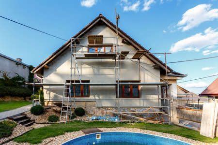 Construction or repair of the rural house, fixing facade, insulation and using color photo