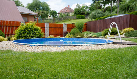 small home swimming pool in rural garden in sunny day