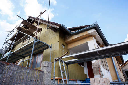 Construction or repair of the rural house, fixing facade, insulation and using color