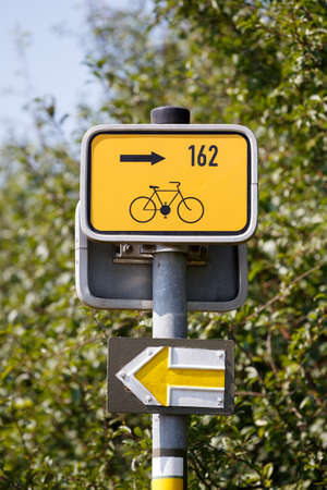 Starting point for cyclists on metal poles in the rural landscape photo