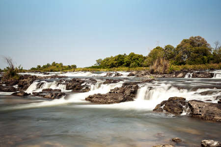 Famous Popa falls in Caprivi, North Namibia, with long exposure Stock Photo