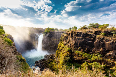zambia: The Victoria falls is the largest curtain of water in the world (1708 meters wide). The falls and the surrounding area is the National Parks- Zambia, Zimbabwe