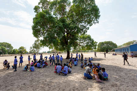 NAMIBIA, KAVANGO, OCTOBER 15: Happy Namibian school children waiting for a lesson. Kavango was the region with the highest poverty level in Namibia, more than 50% of the population were classified as poor. October 15, 2014, Namibia Editorial