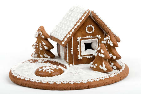 Holiday Gingerbread house isolated on white, christmas cookie photo