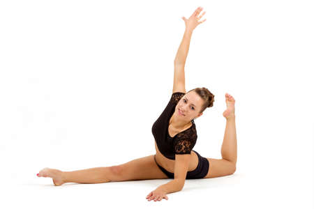 beauty contortionist practicing gymnastic yoga isolated on white background, Young professional gymnast woman photo
