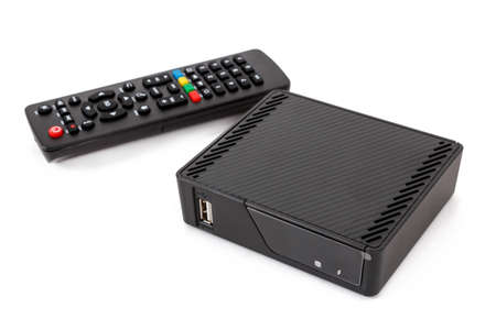 Android TV set top box receiver with remote controler isolated on white