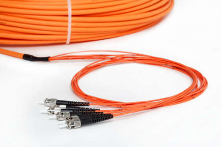 fiberoptic: group of fiber optic ST connectors on orange patchcord
