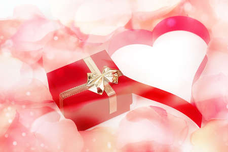 rose petals, heart and valentine present box background with space for text photo