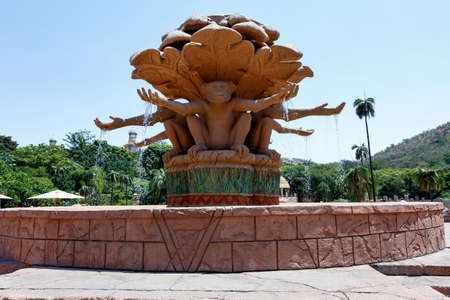 lost city: Gigantic monkey statues on fountain near bridge in famous Lost City in Sun City, South Africa.
