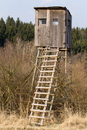 Wooden Hunters High Seat hunting tower in rural Landscape, Czech Republic Scenery photo