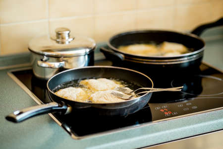 breadcrumbs: fried steak, traditional Czech dish on the hot plate