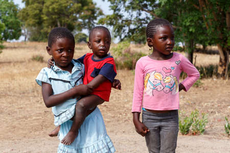 diversity of the region: NAMIBIA, KAVANGO, OCTOBER 15: Unidentified dirty and poor Namibiann childrens near town Rundu. Kavango is region with the highest poverty level in Namibia. October 15, 2014, Namibia