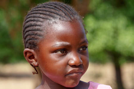 diversity of the region: NAMIBIA, KAVANGO, OCTOBER 15: Unidentified child girl near town Rundu. Kavango is region with the highest poverty level in Namibia. October 15, 2014, Namibia