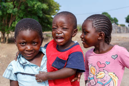 diversity of the region: NAMIBIA, KAVANGO, OCTOBER 15: An unidentified dirty and poor Namibiann childrens near town Rundu, Kavango with the highest poverty level in Namibia. October 15, 2014, Namibia