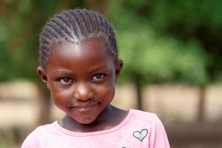 diversity of the region: NAMIBIA, KAVANGO, OCTOBER 15: An unidentified child girl near town Rundu in Kavango region, with the highest poverty level in Namibia. October 15, 2014, Namibia Editorial