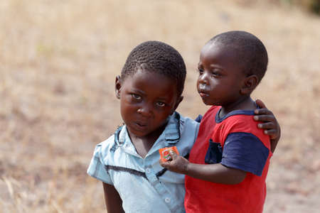 diversity of the region: NAMIBIA, KAVANGO, OCTOBER 15: An unidentified dirty and poor Namibiann childrens near town Rundu in Kavango region, with the highest poverty level in Namibia. October 15, 2014, Namibia