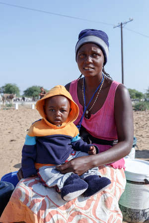 diversity of the region: NAMIBIA, KAVANGO, OCTOBER 15: An unidentified namibian children with mother near town Rundu in Kavango region, with the highest poverty level in Namibia. October 15, 2014, Namibia Editorial
