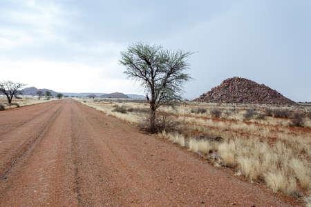 moonscape: endless road in fantrastic Namibia moonscape landscape, Hardap region