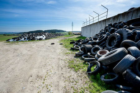 Pile of old tires in farm agro company, Czech Republic photo