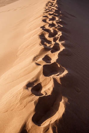 best place: human footprints on dune in Hidden Vlei in Namib desert, best place of Namibia Stock Photo