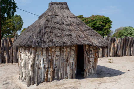 housed: Traditional african village with housed and wooden fence in Namibia, near town Kavango in region with the highest poverty level in Namibia Stock Photo
