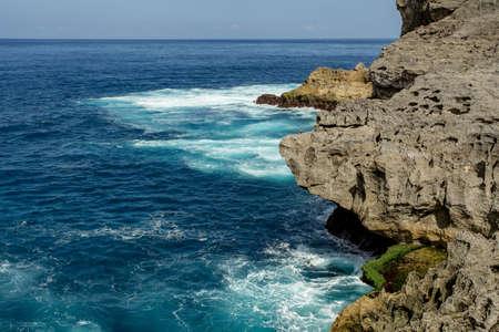 sea cliff: coastline at Nusa Penida island near Pasih Uug (Broken Beach), Bali Indonesia