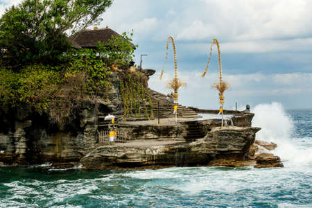 bali temple: famous Tanah Lot Temple on Sea in Bali Island Indonesia with blue sky and waves