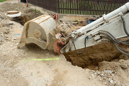 constructing: excavator ploughshare on trench - constructing canalization in european project - wastewater treatment plant, ecology project Stock Photo