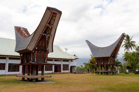 celebes: Details of outstanding local Toraja ethnic architecture, wood carvings, paintings and traditional decoration with rooster in Bitung city, North Sulawesi (celebes) Indonesia