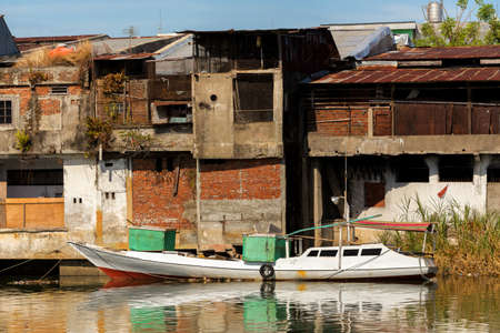 destitution: poor houses with sheet tin by the river, Kota Manado, North Sulawesi, Indonesia