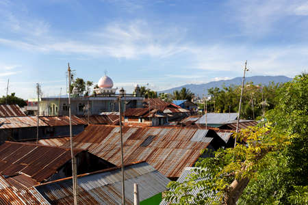 squalor: roof of poor houses with sheet tin by the river, Kota Manado, North Sulawesi, Indonesia