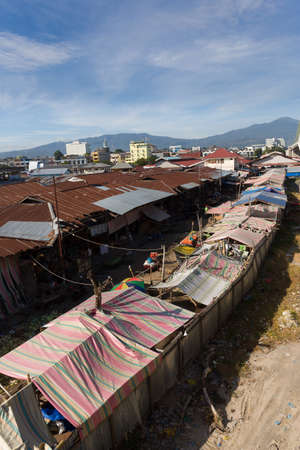 beggary: roof of poor houses with sheet tin by the river, Kota Manado, North Sulawesi, Indonesia