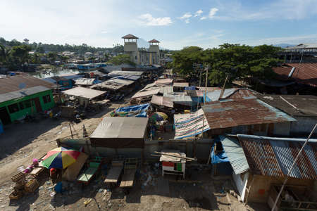 deprivation: poor houses with sheet tin by the river, Kota Manado, North Sulawesi, Indonesia