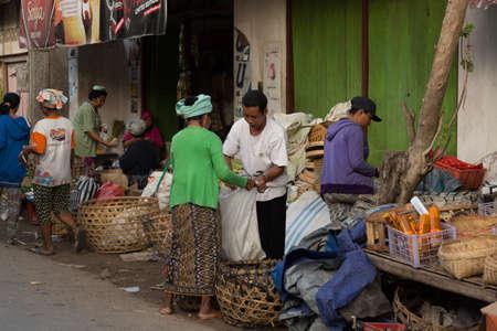 nusa: PENIDA ISLAND, INDONESIA - JUNE 30.2015: woman Hindu at the traditional daily street market, village Toyopakeh, Nusa Penida, Bali June 30. 2015 Indonesia