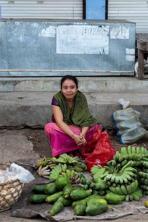 nusa: PENIDA ISLAND, INDONESIA - JUNE 22.2015: woman Hindu at the traditional daily street market, village Toyopakeh, Nusa Penida, Bali June 22. 2015 Indonesia Editorial