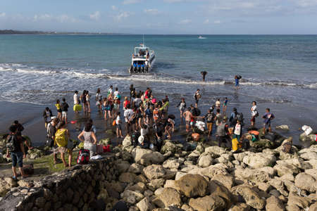 sanur: BALI, SANUR, INDONESIA - JULY 31.2015: Maruti Speed Boat, taking 45 min from Sanur to Nusa Penida. Passengers must enter to the boat directly from the sea. Sanur July 31. 2015 Indonesia
