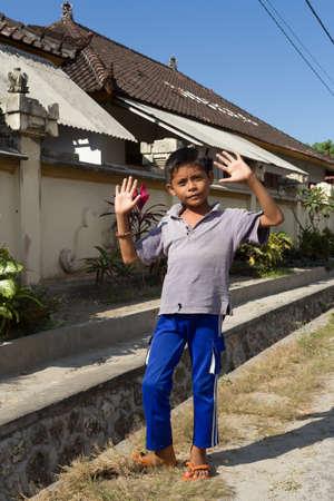 nusa: BALI, NUSA PENIDA ISLAND, INDONESIA - JULY 28.2015: Unidentified Indonesian boy on Toyapakeh street. Nusa Penida July 27. 2015 Indonesia