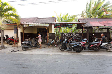 nusa: BALI, NUSA PENIDA ISLAND, INDONESIA - JULY 28.2015: Street motorbike service in Toyapakeh. Nusa Penida July 27. 2015 Indonesia