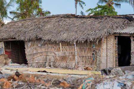 squalor: poor huts of the natives, traditional indonesian poor house - shack on beach, Nusa Penida Island, Toyapakeh. Bali. Stock Photo